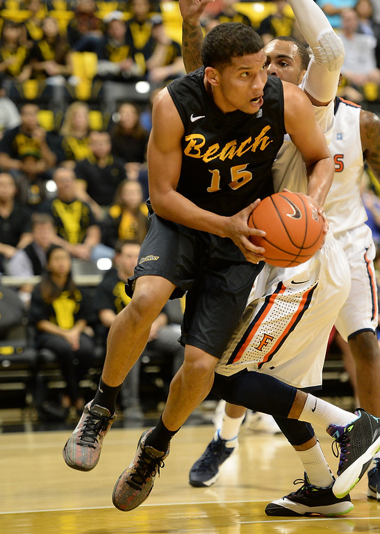 . Long Beach\'s A.J.Spencer (15) clears the ball from the paint against Fullerton in a Big West mens basketball game at the Pyramid Saturday, February 01, 2014, Long Beach CA.   Long Beach won 75-56. CSU Long Beach versus CSU Fullerton Photo by Steve McCrank/Daily Breeze