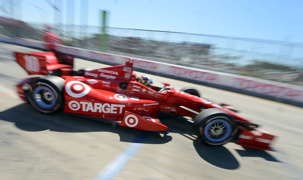 . (Will Lester/Staff Photographer)  Indycar driver Dario Franchitti leaves the pits Friday morning April 19, 2013 at the 39th annual Toyota Grand Prix of Long Beach.