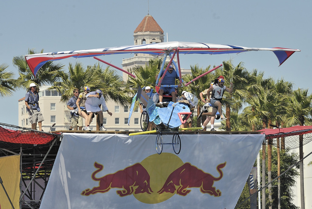 ". LONG BEACH, CALIF. USA -- John Sangmeister pilots his team\'s Flugtag entry ""Fish \'n CHiPs\"" in Rainbow Harbor in Long Beach, Calif. on August 21, 2010. Thirty five teams competed in the Red Bull event where teams build homemade, human-powered flying machines and pilot them off a 30-foot high deck in hopes of achieving flight.  Flugtag means \""flying day\"" in German. They are on distance, creativity and showmanship..Photo by Jeff Gritchen / Long Beach Press-Telegram.."