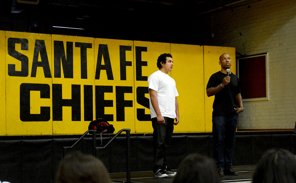 Description of . Motivational speaker Keith Hawkins speaks to students at Santa Fe High School Tuesday morning, March 19, 2013 as the Santa Fe Springs school holds their 23rd annual Diversity Summit this week. (SGVN/Staff Photo by Sarah Reingewirtz)