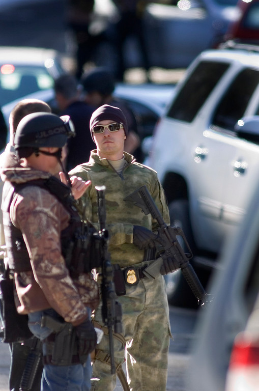 Description of . A tactical team ready getting ready to make their way to the cabin where fugitive former LAPD officer and accused murderer Christopher Jordan Dorner was holding authoritites at bay