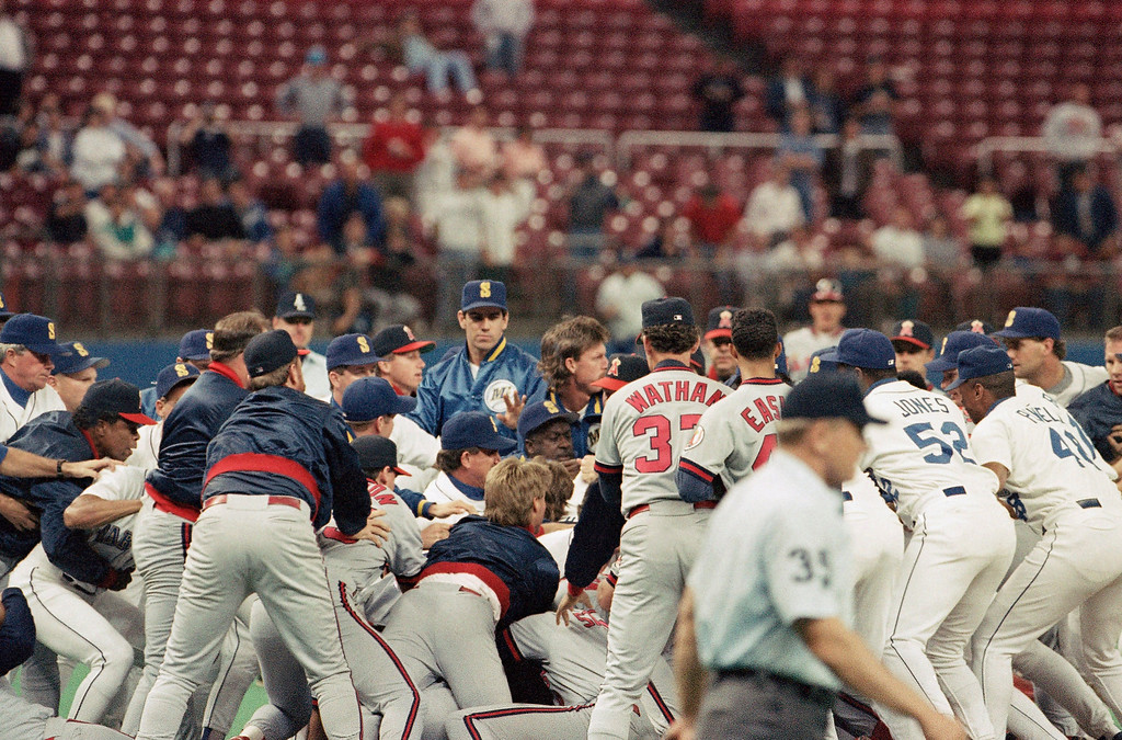 . Members of the California Angels and the Seattle Mariners take part in an eighth-inning brawl on the pitchers mound, Tuesday, Sept. 16, 1992, Seattle, Wash. Both benches emptied after Seattle pitcher Eric Gundersons high and inside throw to Luis Polonia caused the Angels batter to charge the mound. Both Gunderson and Polonia were ejected from the game. California best Seattle 9-0. (AP Photo/Dick Downey)