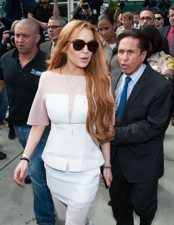 . LOS ANGELES, CA - MARCH 18:  Lindsay Lohan (C) and her lawyer Mark Heller (R) leave after Lohan\'s trial for allegedly lying to police after a car crash, reckless driving and violating her probation for a 2011 jewelry theft conviction at Airport Branch Courthouse of Los Angeles Superior Court March 18, 2013 in Los Angeles, California. Lohan pleaded no contest to two counts in a plea deal and sentenced to 90 days in locked rehab, 30 days community labor and 18 months psychotherapy.  (Photo by Valerie Macon/Getty Images)