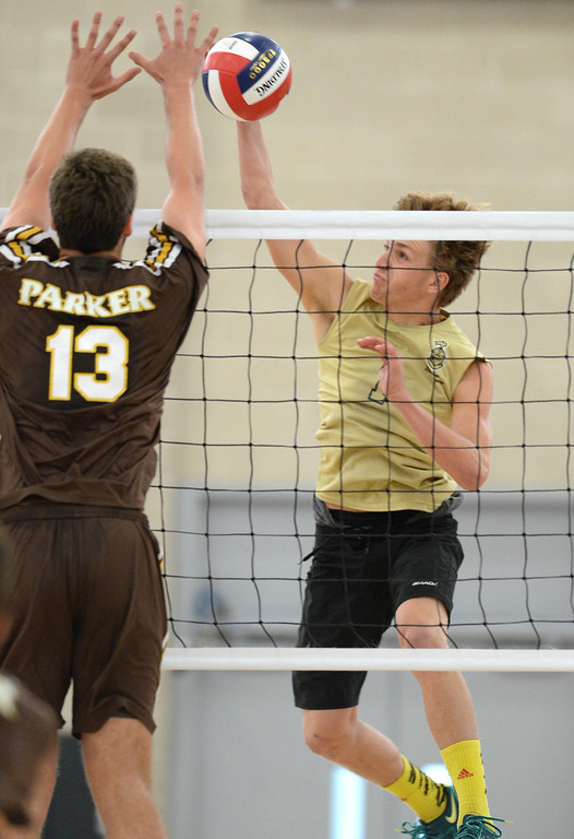 . Bishop Montgomery\'s Eddie Specht (1) goes for a kill against Parker\'s David Nussbaum (13) in a Southern California Regional Division III Final volleyball match Saturday at Santiago Canyon College in Orange. The match came down to the final points of the fifth game, with Bishop Montgomery losing the heart-breaker. Bishop Montgomery vs. Francis Parker (San Diego) 20130525 Photo by Steve McCrank / Staff Photographer