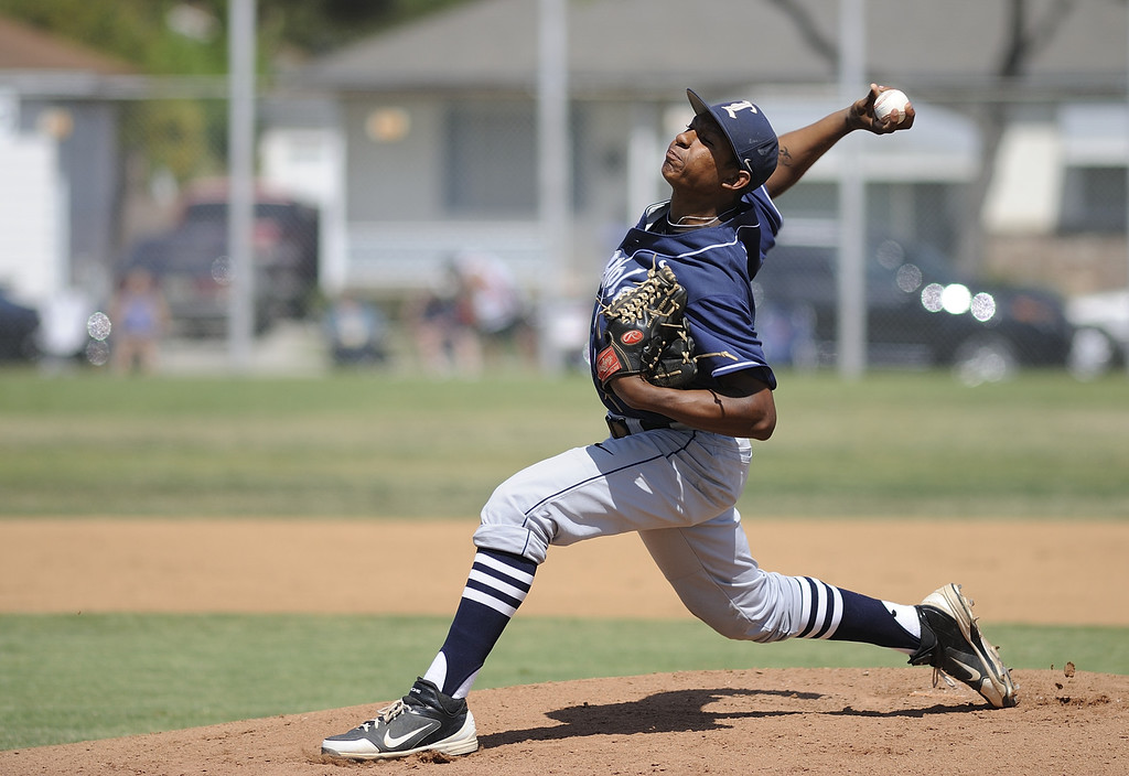 . LAKEWOOD, CALIF. USA -- Loyola\'s Lane Coyne (6) delivers a pitch against Lakewood during their CIF-SS Division I playoff ga,e in Lakewood, Calif., on Tuesday, May 21, 2013. Loyola defeated Lakewood, 6 to 3. Photo by Jeff Gritchen / Los Angeles Newspaper Group