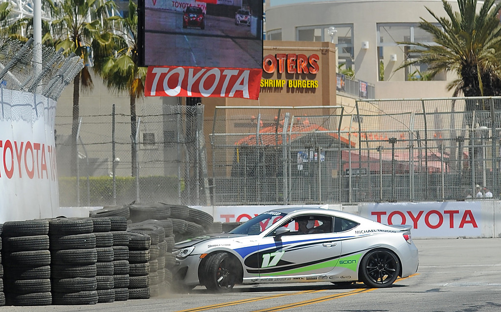 . 04-19-2013-(LANG Staff Photo by Sean Hiller)- Celebrity driver Michael Trucco crashes on turn 1 during practice for the Toyota Pro/Celebrity Race at the Toyota Grand Prix Friday in Long Beach.