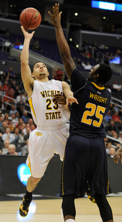 . Wichita #23 Fred VanVleet shoots over La Salle #25 Jerrell Wright. Wichita State defeated La Salle 72-58 at Staples Center for the West Regional of the NCAA Division I Men\'s Basketball Championships. Los Angeles,CA 3/28/2013(John McCoy/Staff Photographer