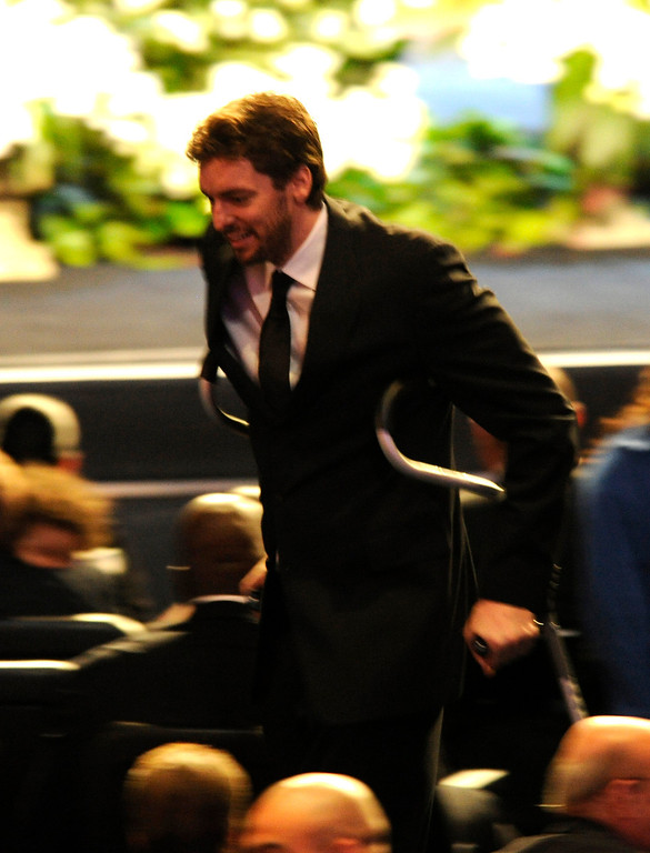 . Pau Gasol gets to his seat using crutches before the Jerry Buss Memorial Service at Nokia Theatre, Thursday, February 21, 2013. (Michael Owen Baker/Staff Photographer)