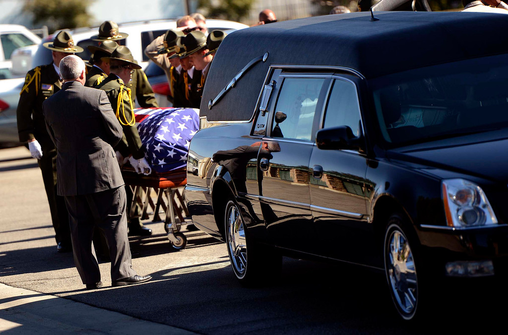 . The body of San Bernardino County Sheriff\'s  Deputy Jeremiah MacKay is loaded into a hearse at the SBCO Coroner\'s Office in San Bernardino February 14, 2013. The Department held a small service with Honor Guard, and the playing of bag pipes prior to a procession led by a motorcade to Mountain View Mortuary in San Bernardino. MacKay was the final victim of fugitive Christopher Dorner.   