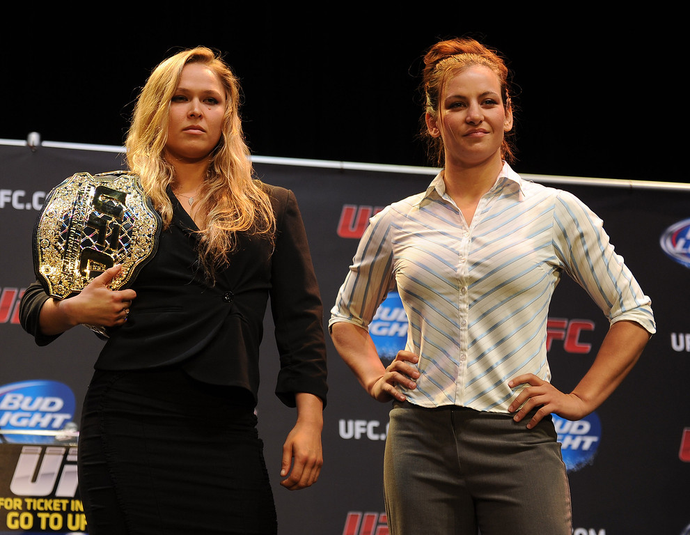 . UFC woman\'s bantamweight champion Ronda Rousey and challenger Miesha Tate pose for some photos during the UFC World Tour at Club Nokia Tuesday, July 30, 2013 in Los Angeles. (Hans Gutknecht/Los Angeles Daily News)