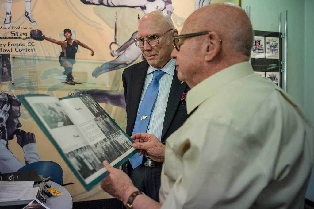 . LA Valley College\'s first student, Lloyd Jones, left and and fellow alumni Al Zucker, who has taught on campus for more than 50 years, look over the yearbook from 1949. Jones, a world renowned aviation artist was invited back to campus for a Deans reception.  Photo by David Crane/Los Angeles Daily News.