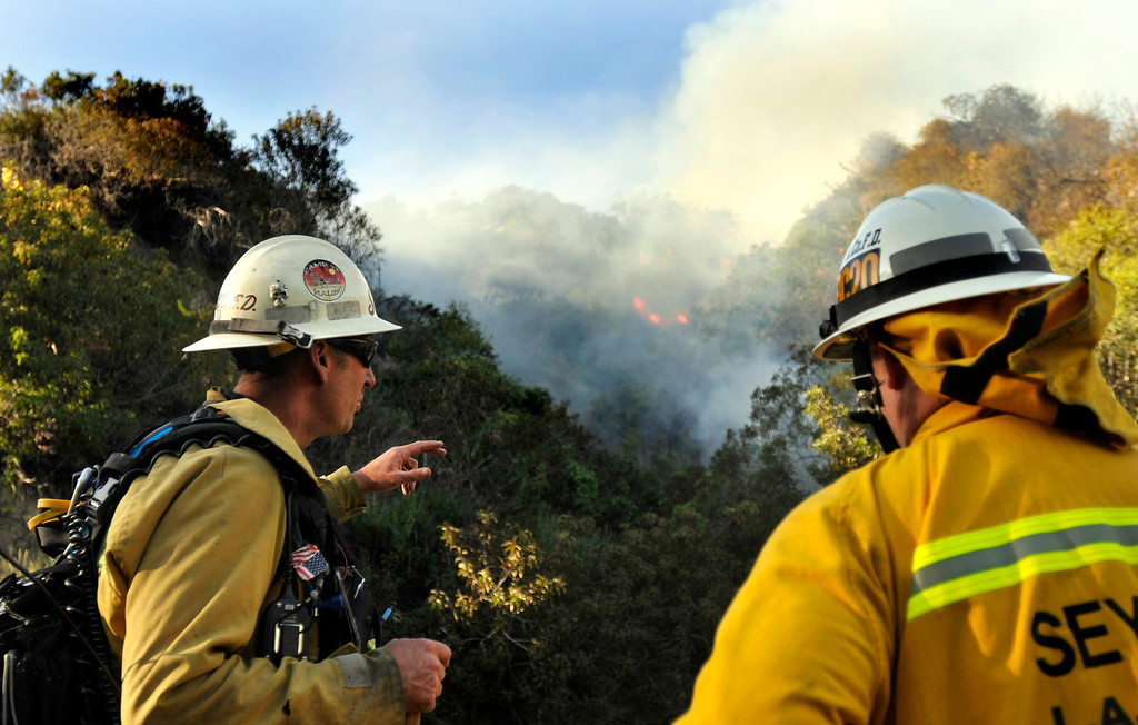 Description of . Firefighters from all surrounding agencies came in to help the Monrovia Fire Dept. battle a major wildfire in the foothills above their city, Saturday April 20, 2013.  (Mike Mullen)