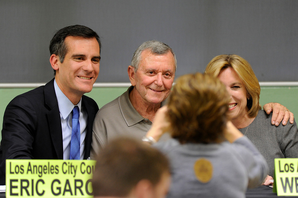 . Sherman Oaks Homeowners Association vice-president Jules Feir, center, has his picture taken with mayoral candidates Eric Garcetti and Wendy Greuel before their debate at Notre Dame High School, Wednesday, April 17, 2013. (Michael Owen Baker/Staff Photographer)