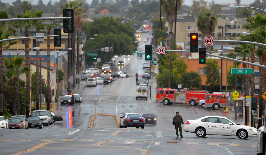 . North and southbound lanes of Cherry Avenue are shut down as Signal Hill and Long Beach police and SWAT search for a suspect in the area of 20th St and St Louis Ave. in SIGNAL HILL, CA on Friday, February 28, 2014.  (Photo by Scott Varley, Daily Breeze)