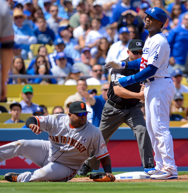 . Giant\'s Pablo Sandoval tagged out Dodger\'s Carl Crawford on this third base play during opening day at Dodger Stadium Monday.  Photo by David Crane/Los Angeles Daily News.