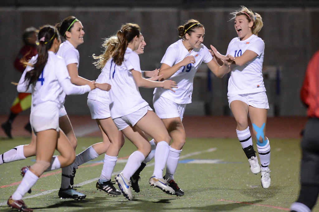 . Westlake teammates celebrate with Nicole Molen who scored the only goal of the game during quarterfinal action.  Westlake defeated Mira Costa 1-0 in the quarterfinal.  Photo by David Crane/Staff Photographer