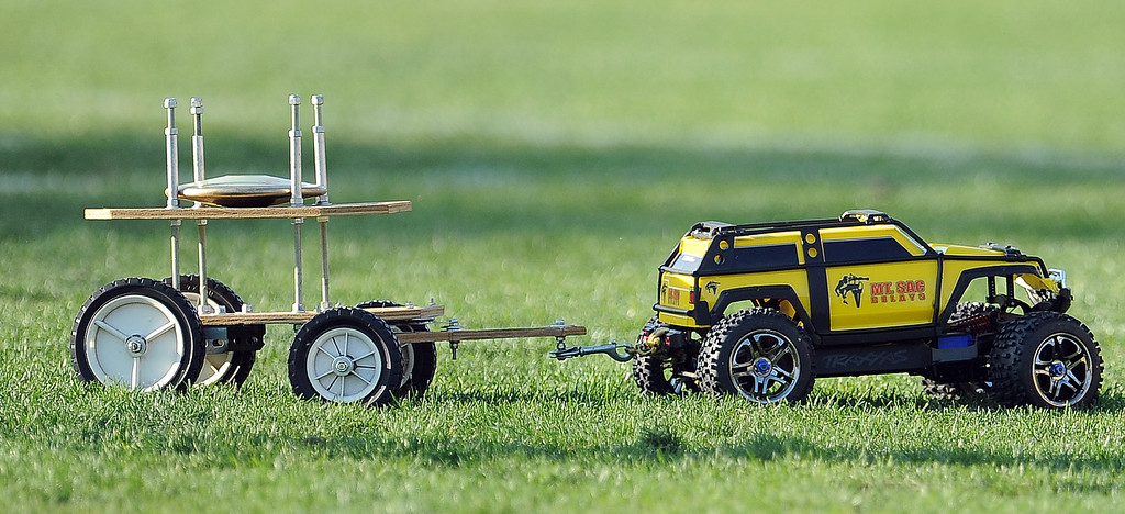 Description of . A remote controlled truck carries discus across the field during the Mt. SAC Relays in Hilmer Lodge Stadium on the campus of Mt. San Antonio College on Saturday, April 20, 2012 in Walnut, Calif.    (Keith Birmingham/Pasadena Star-News)