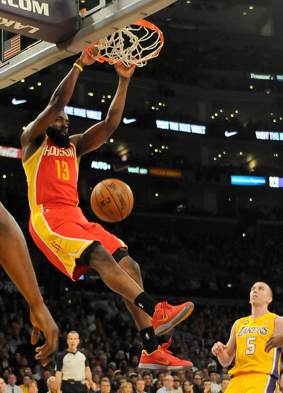 . Rockets#13 James Harden dunks in the first quarter. The Lakers faced the Houston Rockets in the final home game of the year at Staples Center in Los Angeles, CA 4/17/2013(John McCoy/Staff Photographer