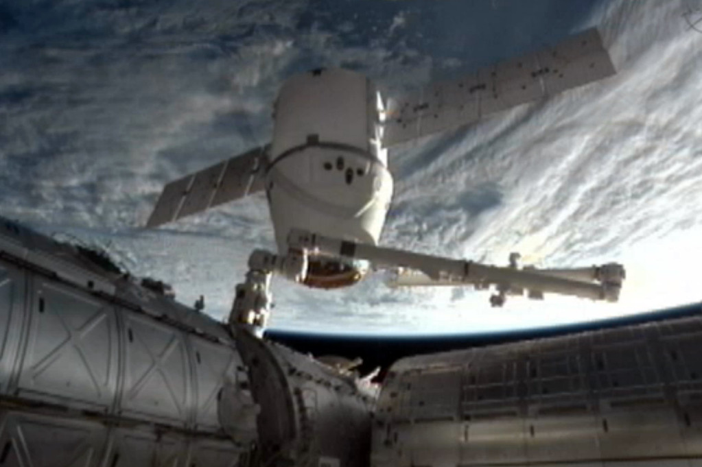 Description of . This image provided by NASA-TV shows the SpaceX Dragon commercial cargo craft as it is backed away from the International Space Station early Tuesday March 26, 2013 by the International Space Station's Canadarm2 robotic arm. The Dragon is expected to splash down in the eastern Pacific ocean approximately 246 miles off the coast of Baja Calif., later this morning. (AP Photo/NASA)
