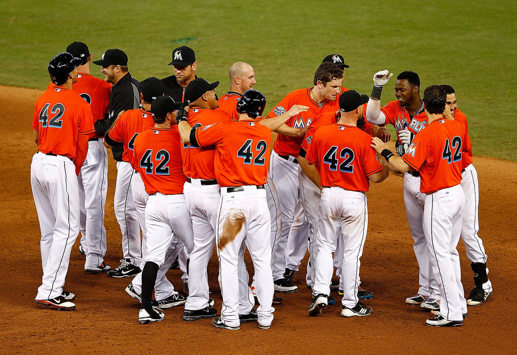 Description of . MIAMI, FL - APRIL 15:  Hanley Ramirez of the Miami Marlins celebrates hitting a bases loaded walk off single in the 11th inning during a game against the Houston Astros at Marlins Park on April 15, 2012 in Miami, Florida. Both teams wore the number 42 in honor of Jackie Robinson Day.  (Photo by Mike Ehrmann/Getty Images)