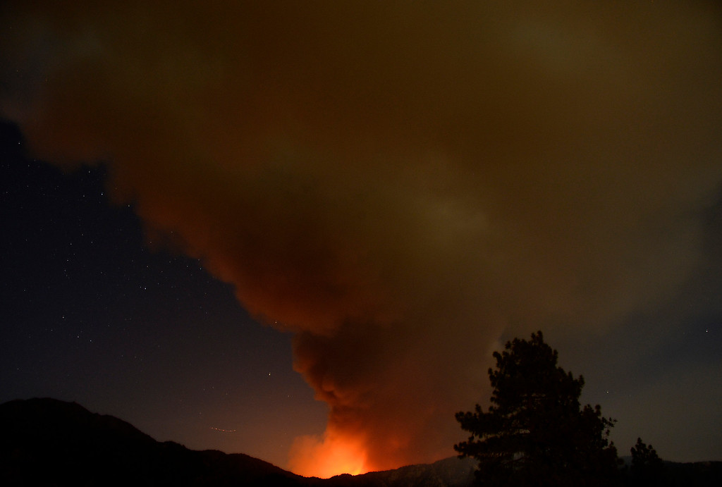 . Looking like a volcano erupting at night the Mountain Fire shows no slowing down near Idyllwild, California July 18, 2013. The blaze erupted on Monday afternoon about 100 miles (161 km) east of Los Angeles in the scenic but rugged San Jacinto Mountains that overlook Palm Springs, Rancho Mirage and several smaller desert towns.  Photo by Gene Blevins/LA DailyNews