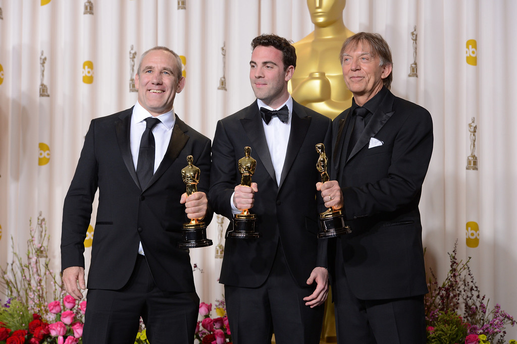""". Simon Hayes, Mark Paterson and Andy Nelson  accept the award for best sound mixing for \""""Les Miserables\"""" backstage at the 85th Academy Awards at the Dolby Theatre in Los Angeles, California on Sunday Feb. 24, 2013 ( David Crane, staff photographer)"""