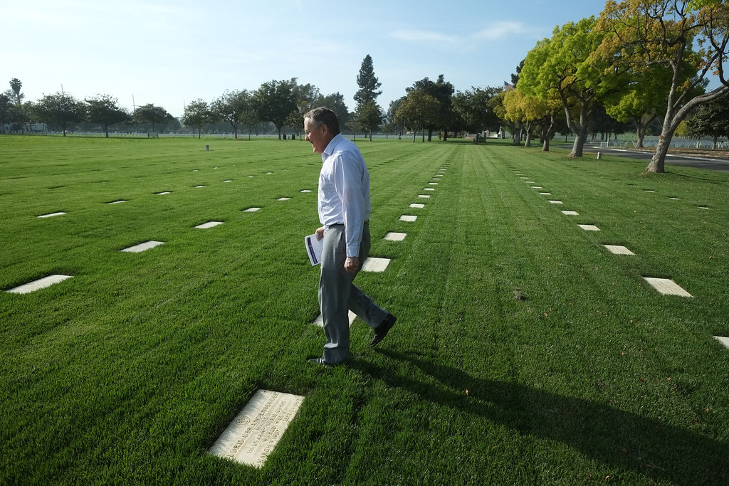 . Researcher William Beigel searches through the thousands of gravestones at the Los Angeles National Cemetery Tuesday. Beigel researches and documents UCLA alumni who were killed in WWII. 20130326 Photo by Steve McCrank / Staff Photographer