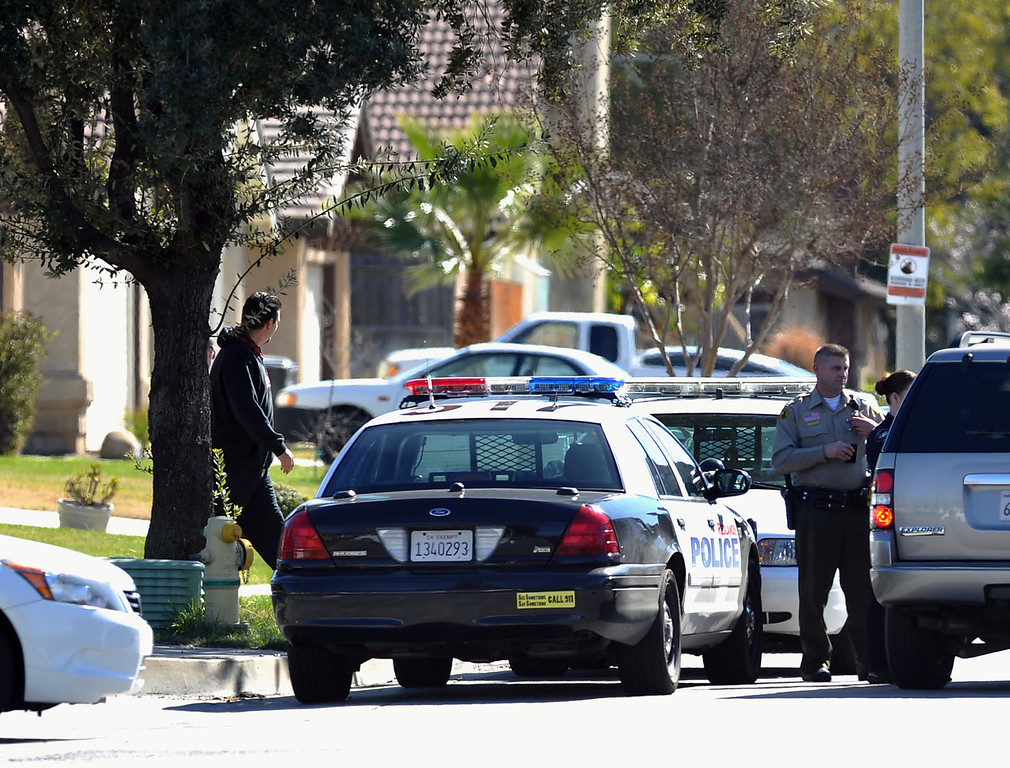 . Redlands police and sheriff\'s deputies station themselves outside the home of slain Deputy Jeremiah MacKay in Redlands, Calif on Wednesday February 13, 2013. MacKay, a San Bernardino County Sheriff\'s deputy, was shot and killed by the fired LAPD Officer Christopher Dorner in the mountains of San Bernardino National Forest where it\'s believed Dorner may have died after barricading himself in a cabin that later burned to the ground.