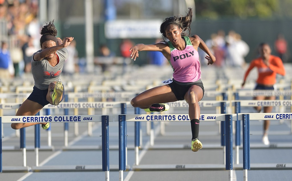 . NORWALK, CALIF. USA -- Poly\'s Ebony Crear competes in the 110 hurdles during the CIF-SS Masters Track and Field Meet in Norwalk, Calif., on Friday, May 24, 2013. Photo by Jeff Gritchen / Los Angeles Newspaper Group