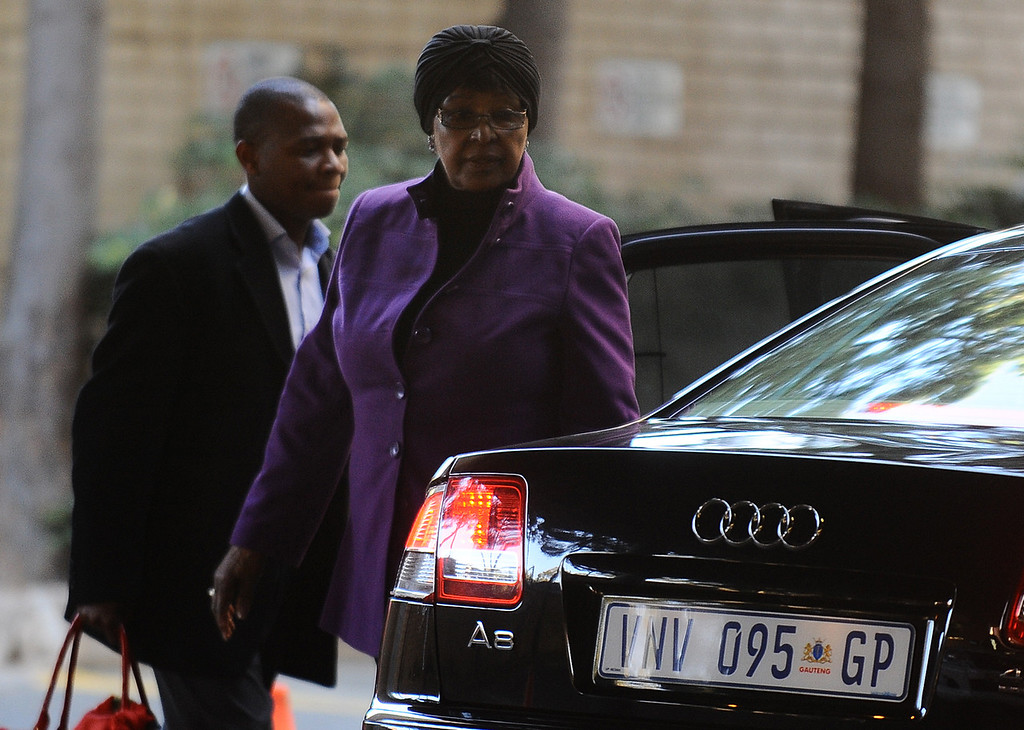. Winnie Madikizela-Mandela, former wife of former president Nelson Mandela arrives at the hospital in Pretoria, South Africa, Monday, June 10, 2013. Nelson Mandela was in serious but stable condition in a Pretoria hospital for the third day Monday with a recurring lung infection, and a foundation led by retired archbishop Desmond Tutu described the 94-year-old anti-apartheid hero as an �extraordinary gift� to South Africa.  (AP Photo)