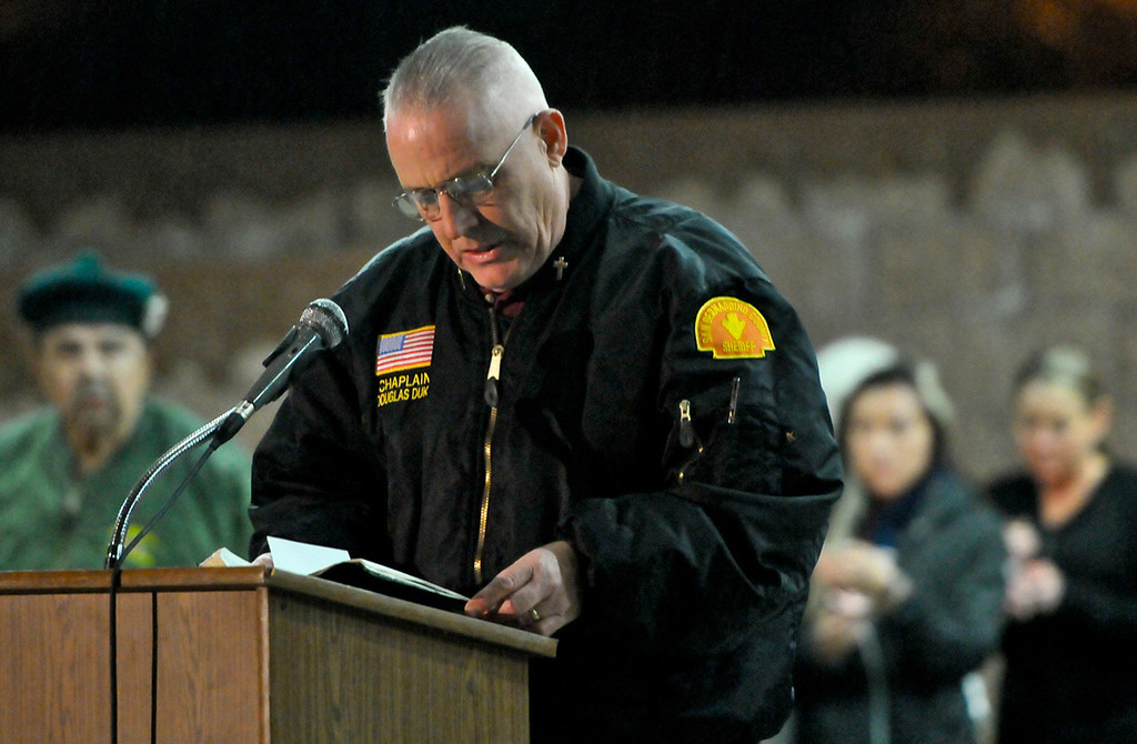 . Despite heavy rainfall, more than 300 people attend a candlelight vigil in honor of fallen San Bernardino County Sheriff\'s Detective Jeremiah MacKay at the Yucaipa Community Center in Yucaipa, Calif. on Tuesday, Feb. 19, 2013. MacKay was killed by fugitive ex-cop Christopher Dorner on Feb. 12 during a fiery shootout, in which Dorner barricaded himself in a cabin near Big Bear and was later found dead of a gunshot wound that authorities believe was self-inflicted. (Rachel Luna / Staff Photographer)