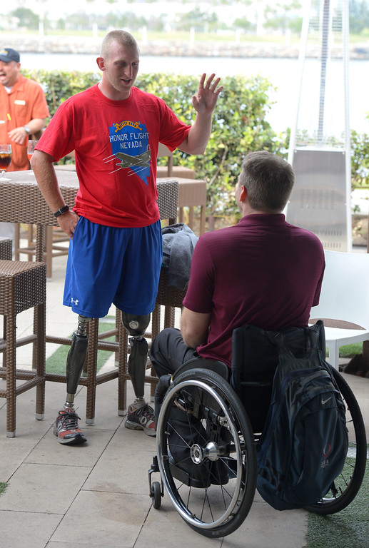 . Double amputee marine veteran Rob Jones is celebrated at a reception at the Hotel Maya in Long Beach, CA on Thursday, April 10, 2014. Jones, left, chats with his 2012 Paralympics rowing teammate Ron Harvey. Jones began riding his bicycle across the country in Maine in October and will his fundraising journey Saturday at Camp Pendleton. (Photo by Scott Varley, Daily Breeze)