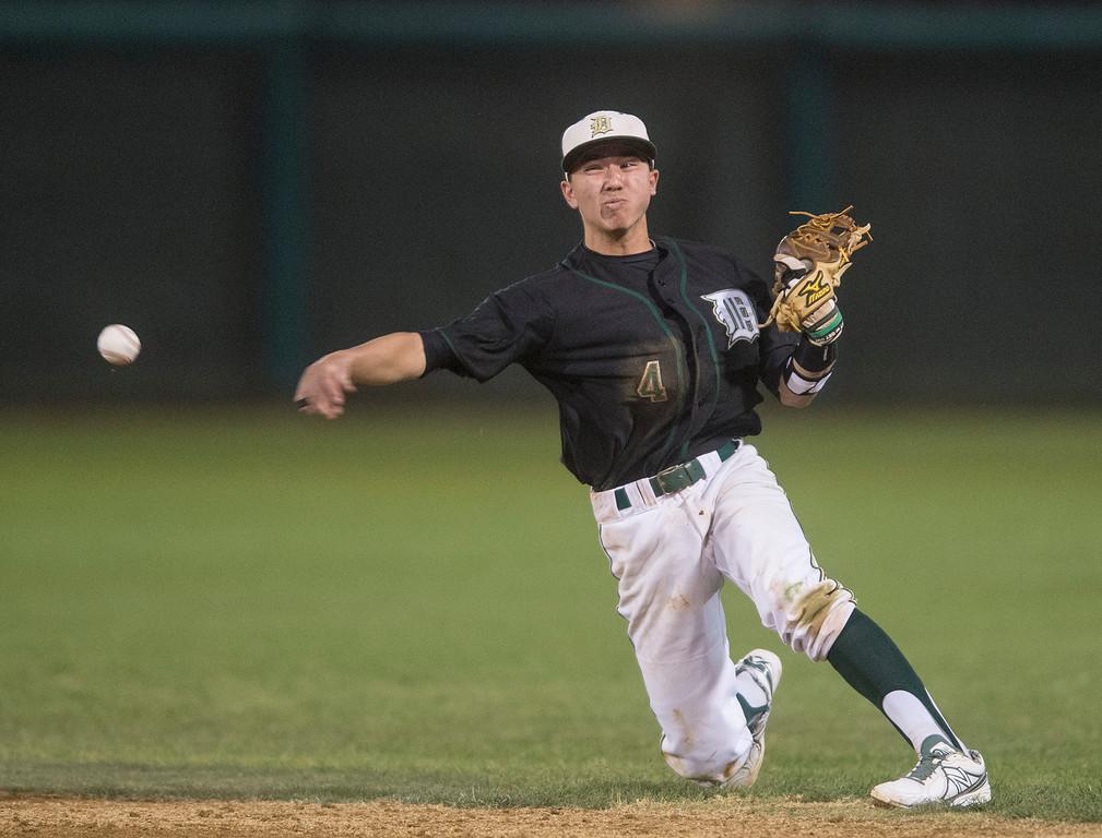 . Damien High School\'s 2B Joshua Silvestro throws out a Los Altos High baserunner during Dick\'s Sporting Goods Baseball Tournament at Mt. SAC Feb. 27, 2013.  (SGVN/Staff photo by Leo Jarzomb)