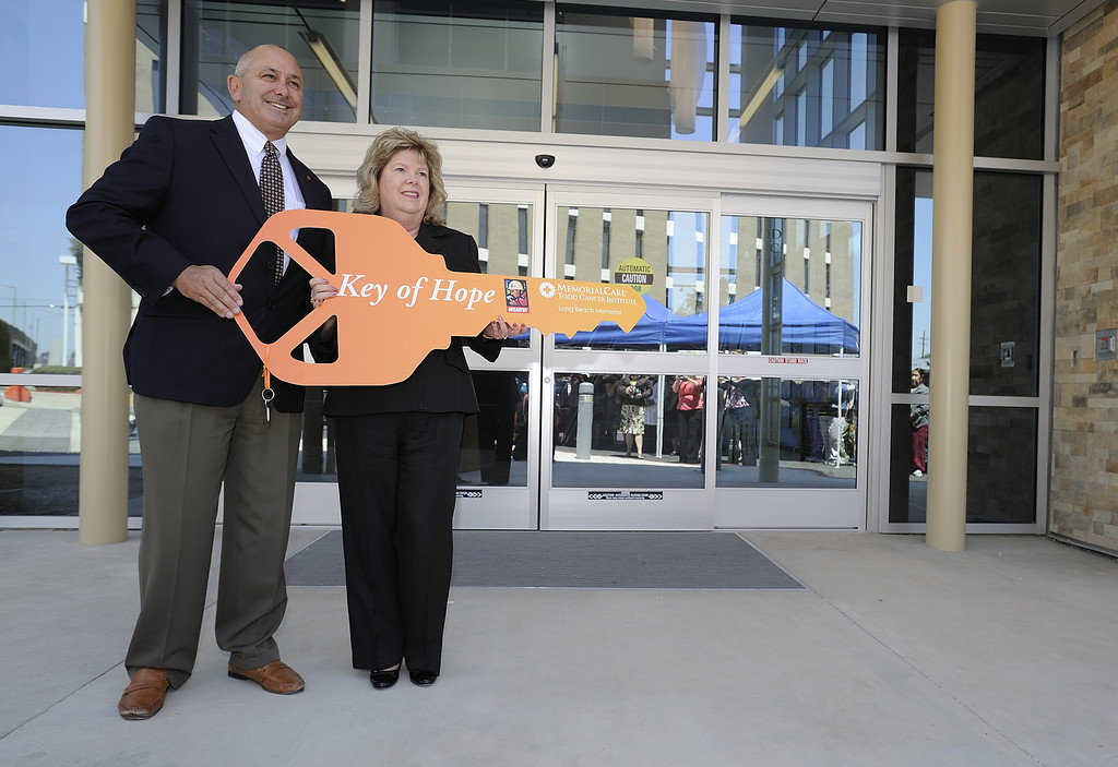 . LONG BEACH, CALIF. USA -- Mike Tuohy, vice president and project executive for McCarthy Construction, left, and Cathy Kopy, executive director of the Todd Cancer Institute, during a ceremony to hand over the key of the Todd Cancer Institute to Long Beach Memorial Medical Center on April 22, 2013. The new $31 million Todd Cancer Pavilion is scheduled to be unveiled to the public on Saturday, June 29 and open to patients on Monday, July 15. Photo by Jeff Gritchen / Los Angeles Newspaper Group