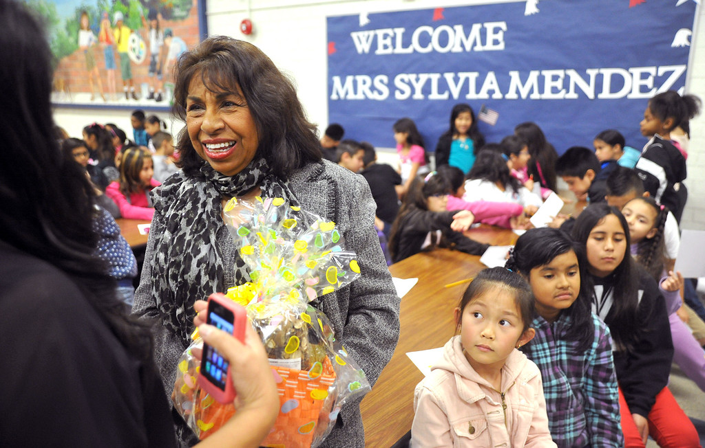 Description of . Medal of Freedom recipient Sylvia Mendez tallks after speaking to students at Jersey Avenue Elementary School in Santa Fe Springs on Thursday March 21, 2013. Mendez is the daughter of Gonzalo Mendez, a Mexican immigrant and Felicitas Mendez, a Puerto Rican immigrant, who fought so that their daughter could have an equal education through the landmark court case battle of Mendez v. Westminster in the 1940s. In 2011, Sylvia was awarded the Medal of Freedom by President Obama. (SGVN/Staff Photo by Keith Durflinger)