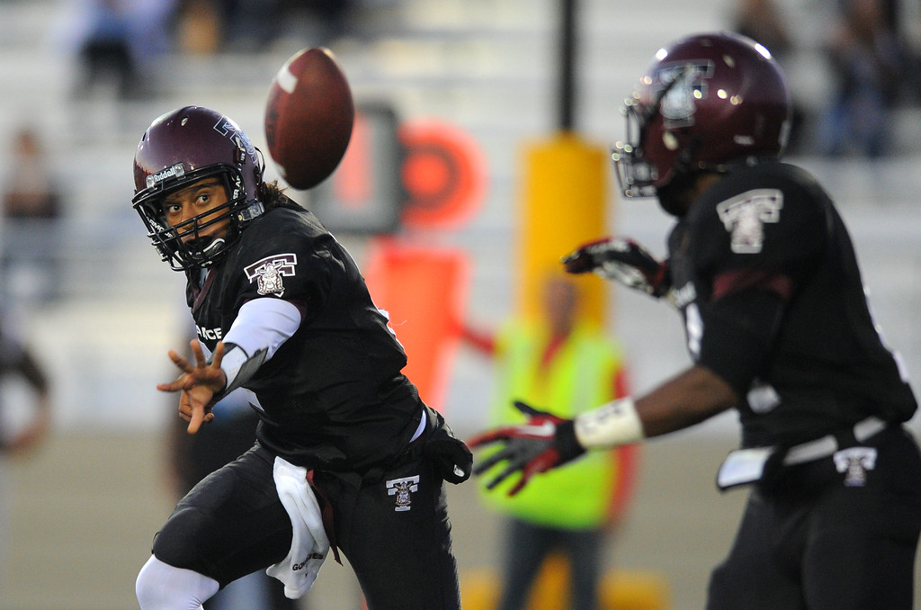 . West High takes on Torrance in a non league football game at Zamperini Stadium in Torrance, CA on Thursday, September 12, 2013. On an option, Torrance QB Gabe Gonsalves, left, pitches the ball back to Bobby Wilson. (Photo by Scott Varley, Daily Breeze)