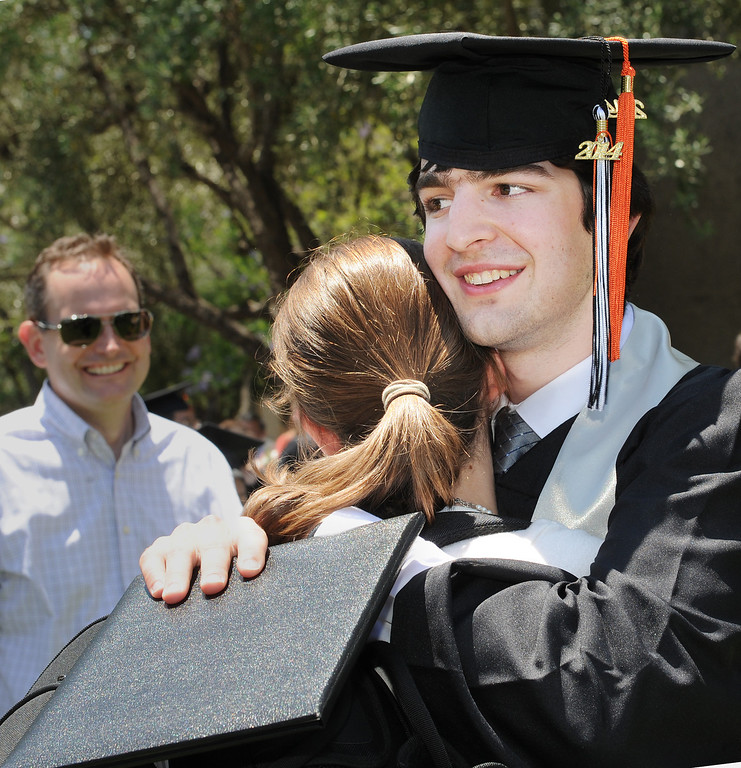 . Robert Wesley Morgan, receives a warm embrace from his girlfriend Madeleine Youngs120th Annual Commencement at California Institute of Technology Friday, June 13, 2014. Morgan whor received his Bachelor of Science in mechanical engineering was one of two people to receive a Mechanical Engineering Award. (Photo by Walt Mancini/Pasadena Star-News)