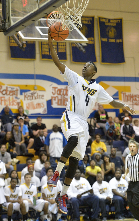. LONG BEACH, CALIF. USA -- Millikan\'s Brian Chambers (0) goes up for a shot against Gahr during their CIF-SS Divison 1-A playoff game in Long Beach on February 15, 2013. Millikan defeated Gahr, 74 to 64. Photo by Jeff Gritchen / Los Angeles Newspaper Group