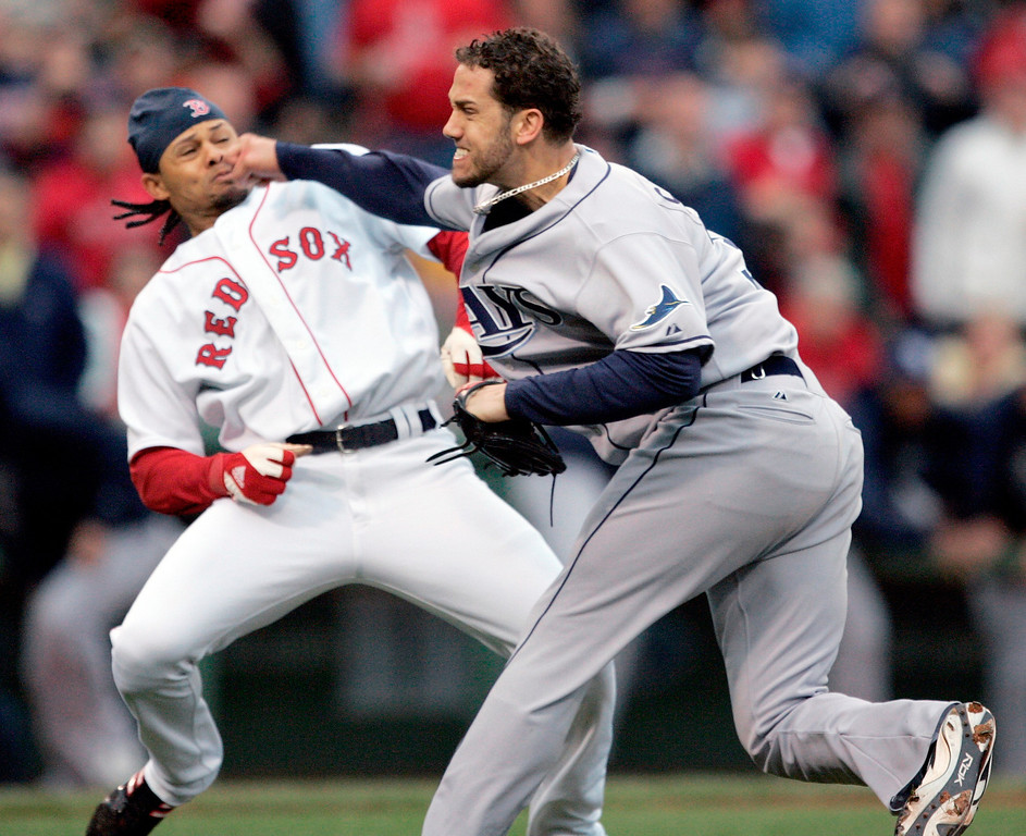 . ** FILE ** In this June 5, 2008, file photo, Tampa Bay Rays pitcher James Shields, right, takes a swing at Boston Red Sox\'s Coco Crisp after Crisp was hit by a pitch and charged the mound in the second inning of a baseball game in Boston. The Rays have scuffled with the Red Sox at least a half-dozen times this decade, punctuated by the wild brawl in June that resulted in eight players getting suspended. (AP Photo/Michael Dwyer, File)