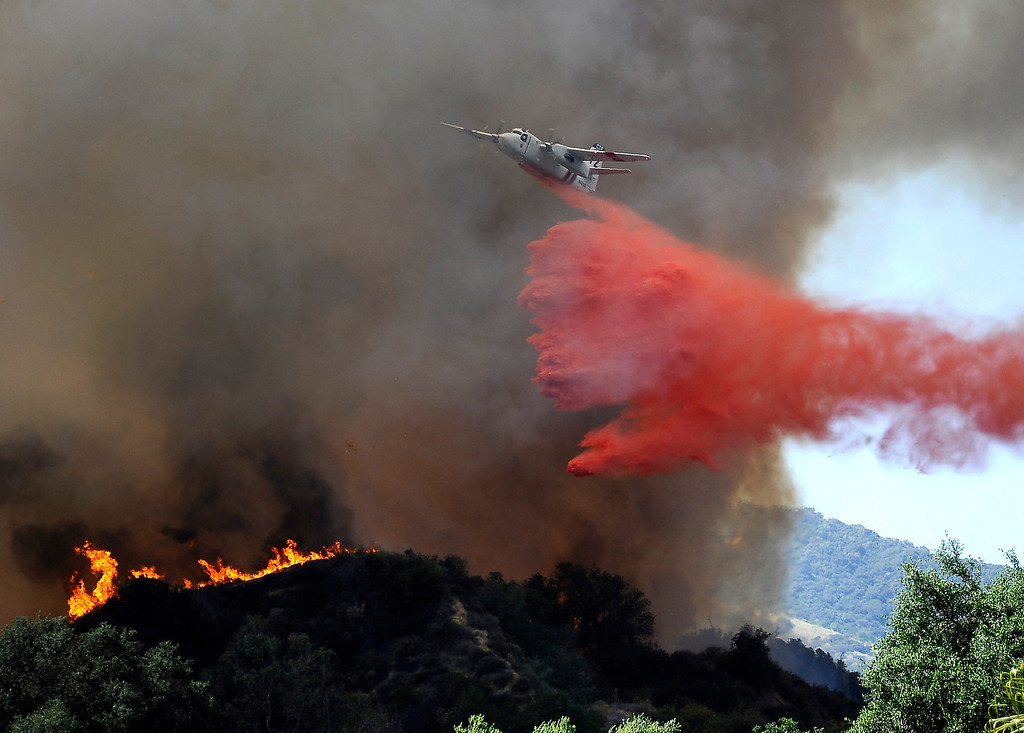 Description of . April 20,2013. MONROVIA. Air tankers make drops on a brush fire in the hillside of north Monrovia grew to 150 acres and prompted mandatory evacuations Saturday afternoon, officials said. The fire, which ignited shortly after 11 a.m. in the 300 block of Madison Ave. was 10 percent contained as of 3 p.m.. Photo by Gene Blevins/LA Daily News