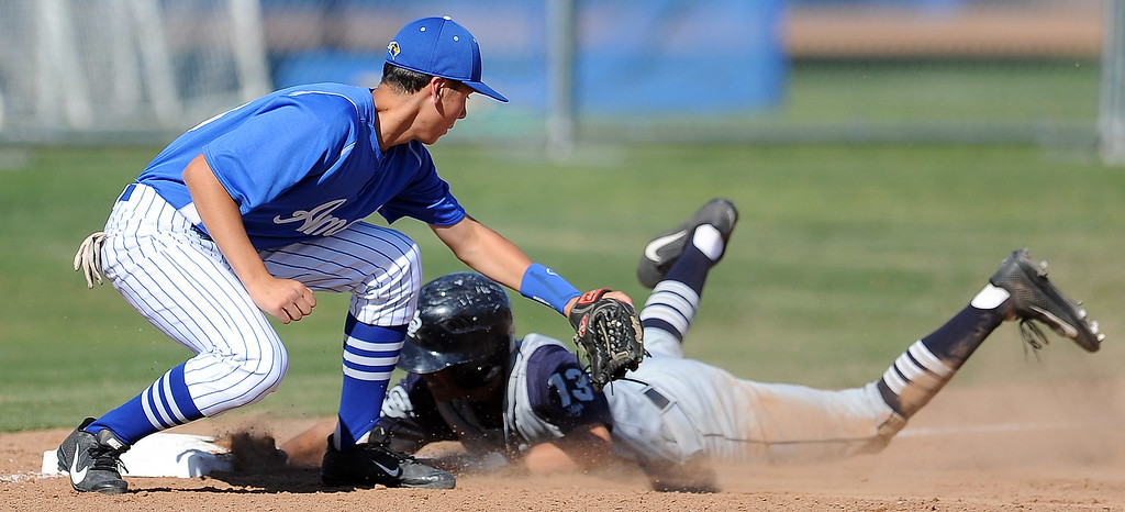 . St. Paul\'s Juan Zuniga (13) safe at third base ahead of the tag by Bishop Amat\'s Anthony Walters in the fourth inning of a prep baseball game at Bishop Amat High School on Friday, April 19, 2012 in La Puente, Calif. Bishop Amat won 3-2.    (Keith Birmingham/Pasadena Star-News)