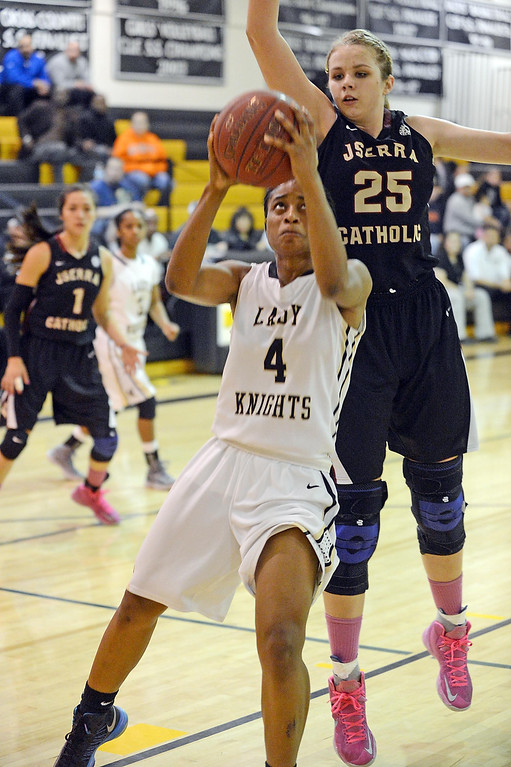 . Bishop Montgomery\'s Chelsea Lidy (4) gets to the basket under JSerra\'s 6\'4\'\' Megan House (25) in a CIF Division IV-AA quarterfinal game Wednesday night in Torrance. 20130220 Photo by Steve McCrank / Staff Photographer