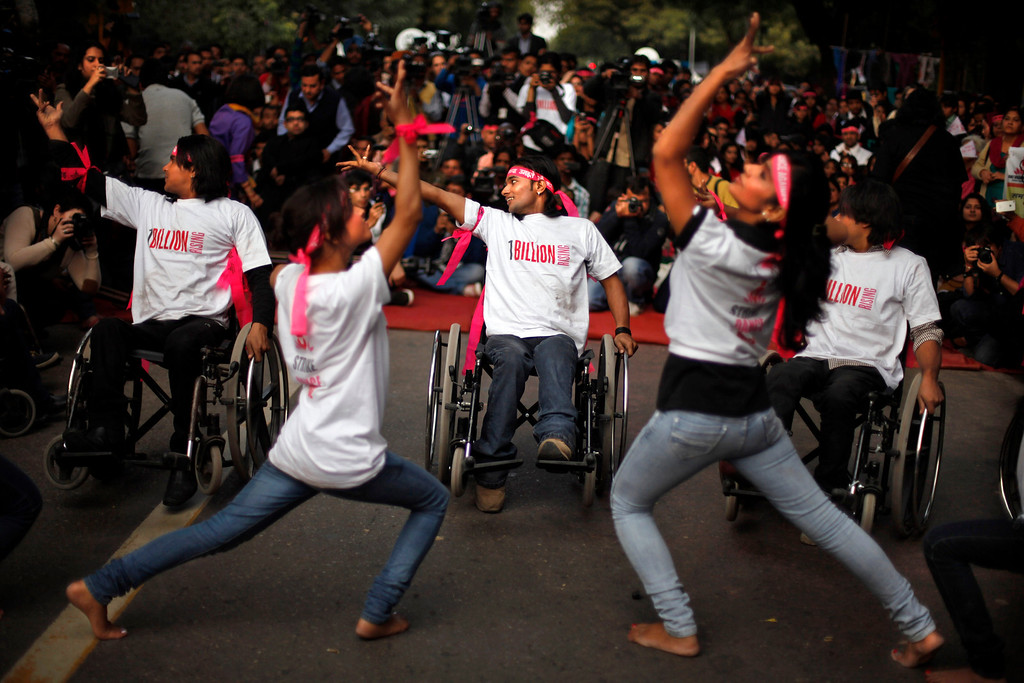 ". Activists perform a dance in an event to support ""One Billion Rising\"" global campaign in New Delhi, India, Thursday, Feb. 14, 2013. Flashmobs, rallies with singing and dancing were organized across the country as part of the campaign, timed to coincide with Valentine\'s Day, to bring an end to violence against women. (AP Photo/Altaf Qadri)"