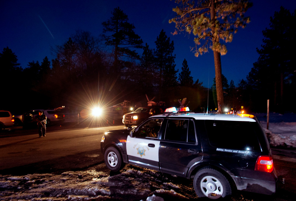 Description of . California Highway Patrol officers block off Highway 38 south of Big Bear City after a deputy shootout with Christopher Dorner in the San Bernardino National Forest on Tuesday evening, Feb. 12, 2013. Dorner is believed to be dead after cabin fire after the shootout. (SGVN/Staff photo by Watchara Phomicinda)