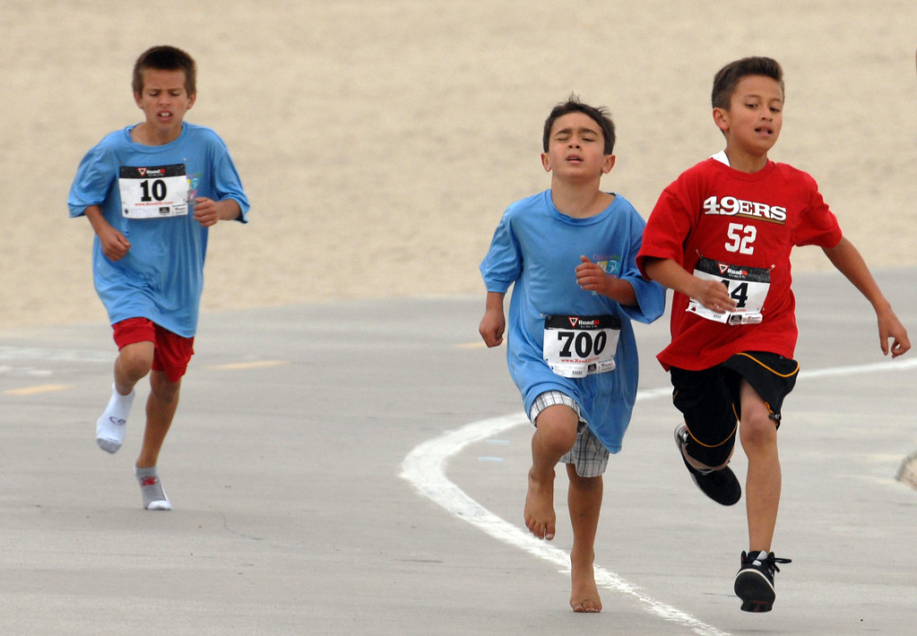 . 5/25/13 - Young runners finishing strong, the 1-mile fun run during the Children Today\'s 5th Annual run/walk at Marina Green Park. The local non-profit, Children Today, is an organization that provides for families and children experiencing homelessness in Long Beach. They\'ve raised $33,184 and their final goal is $50,000. Photo by Brittany Murray / Staff Photographer