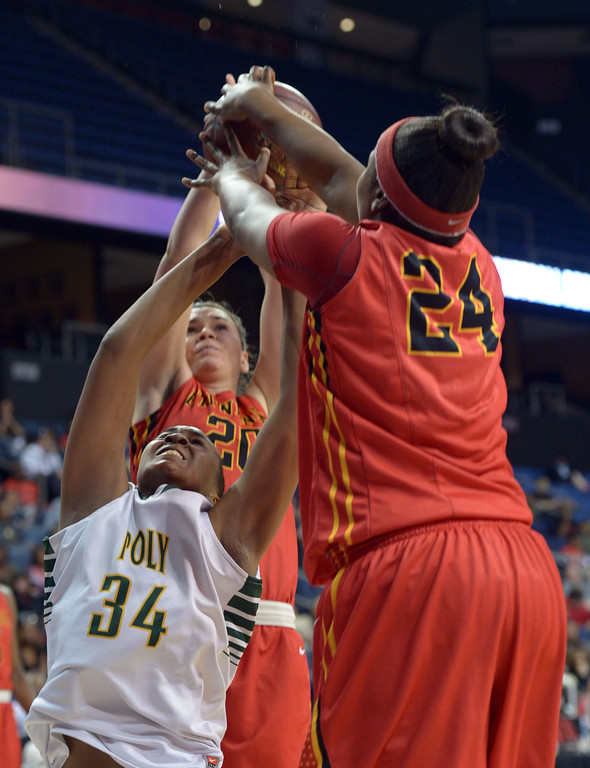 . Etiwanda\'s Amy Okonkwo (24) forces a jump ball as she grabs the ball from Poly\'s Ayanna Clark at Citizens Business Bank Arena in Ontario, CA on Saturday, March 22, 2014. Long Beach Poly vs Etiwanda in the CIF girls open division regional final. 1st half, Photo by Scott Varley, Daily Breeze)