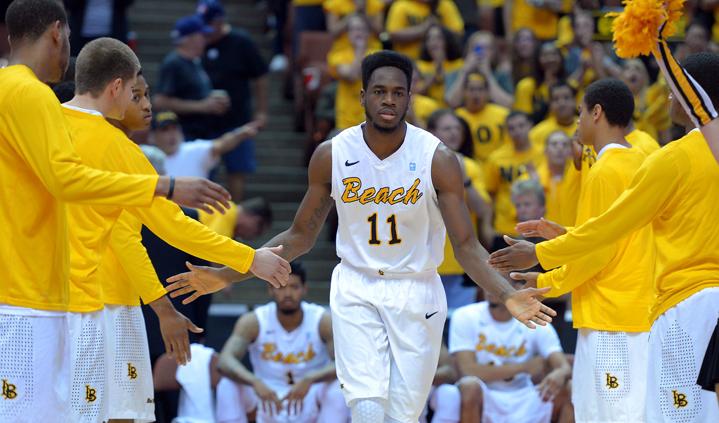 . LBSU\'s David Samuels is introduced at the start of the game at the Honda Center in Anaheim, CA on Thursday, March 13, 2014. Long Beach State vs CSU Fullerton in the Big West men\'s basketball tournament. 1st half. LBSU won 66-56.  Photo by Scott Varley, Daily Breeze)