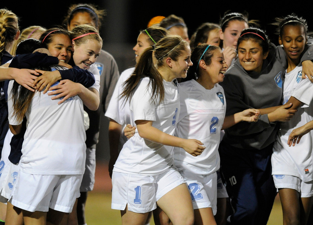 . The Girls from Quartz Hill celebrate after they defeated South Torrance in a sudden death overtime in a Southern Section Division IV Semifinal soccer game. Quartz Hills, CA 2/23/2013(John McCoy/Staff Photographer)