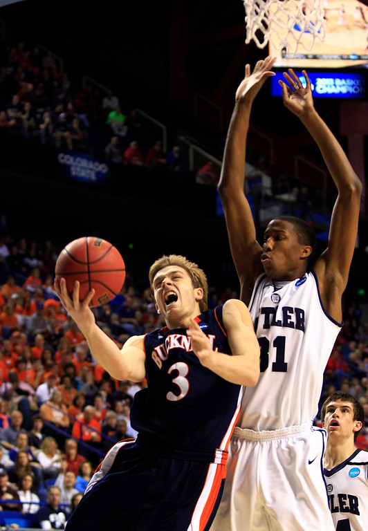 . Bucknell guard Steven Kaspar (3) drives against Butler forward Kameron Woods (31) during the first half  their second round NCAA college basketball tournament game Thursday, March 21, 2013, in Lexington, Ky.  (AP Photo/James Crisp)