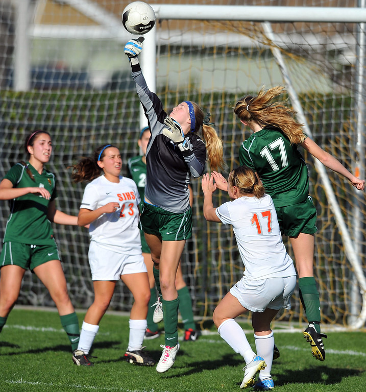 . LAKEWOOD - 02/14/2013  (Photo: Scott Varley, Los Angeles Newspaper Group)  St. Joseph hosts La Reina (Thousand Oaks) in a first-round Division 3 girls soccer playoff game. St. Joseph won 4-0. La Reina goalie Annabel Korzelius punches the ball clear.